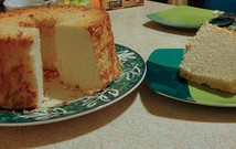 Angel food cake on plate,  one slice on dessert plate