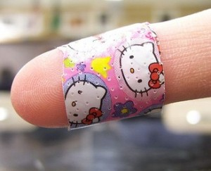 finger wrapped in colorful child's bandaid