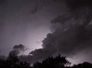 horizon at night; dark storm clouds,lightning; black and white photo