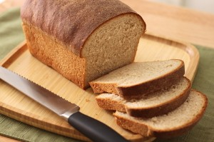 bread loaf, cutting board, bread knife, sliced bread, homemade bread