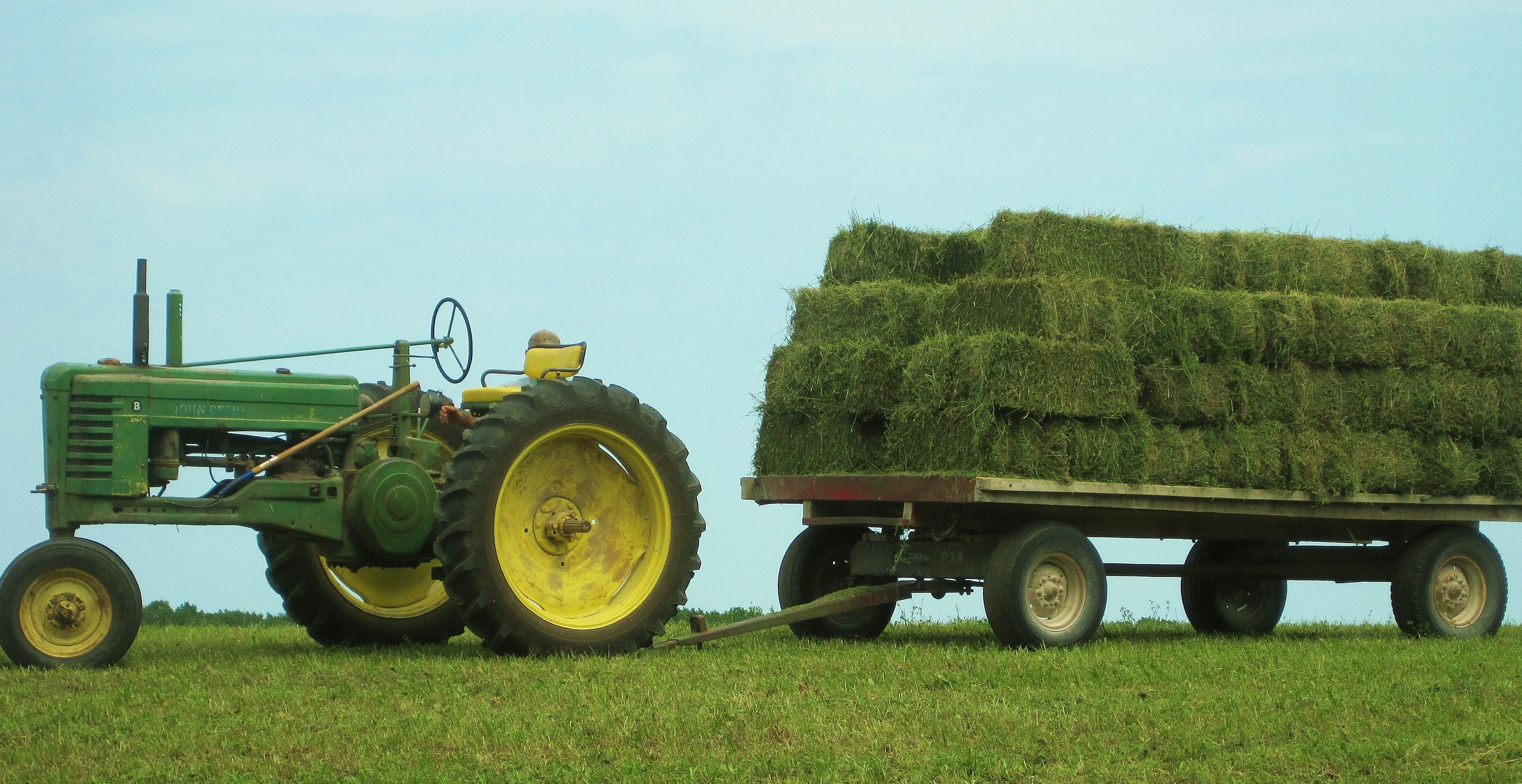 John Deere B and loaded hay wagon