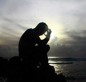 sihlouette, man praying, prayer, seascape,