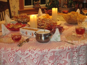 lace table cloth, Christmas table, glass dishes, candles, Christmas treats,