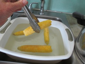 tub of cold water, tub of water, Sweet corn, corn on the cob, tongs,
