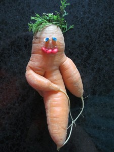 A carrot with 3 roots, smile, blue eyes, green wig, carrot leaves,