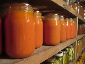 Jars, canning jars, home-canned tomato soup, home-canned soup, Pickles, peaches, applesauce and apple juice in bachground