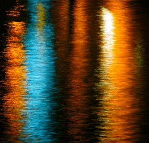 reflections, colored reflectons, reflections on water, nighttime reflections, reflections of lights on water,
