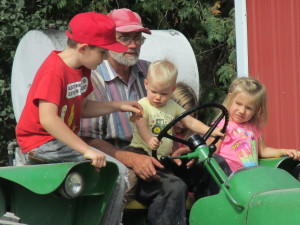 tractor ride, children and grandpa,