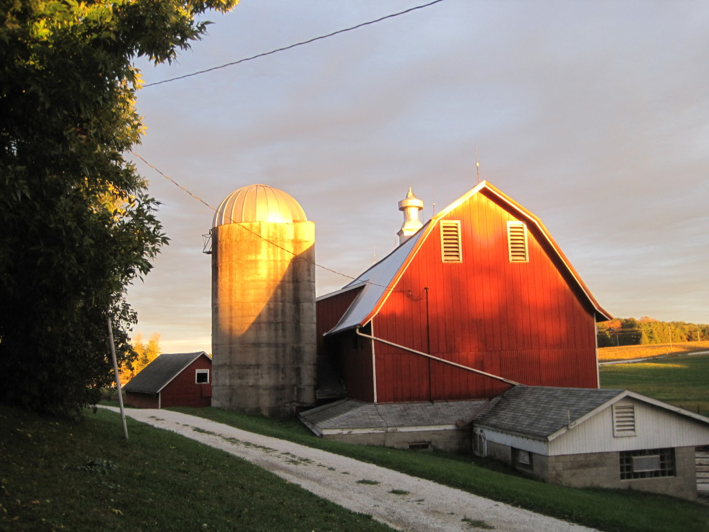 Sun reflection on the barn, Red barn in western sun, Barn and Silo,